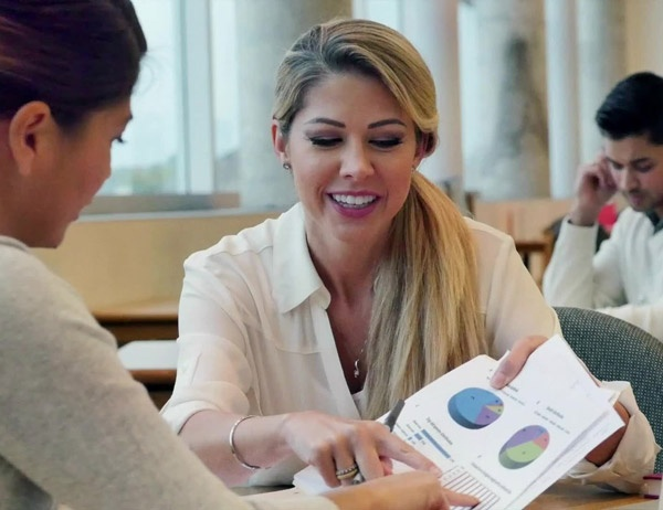 A female investment advisor shares charts with a client